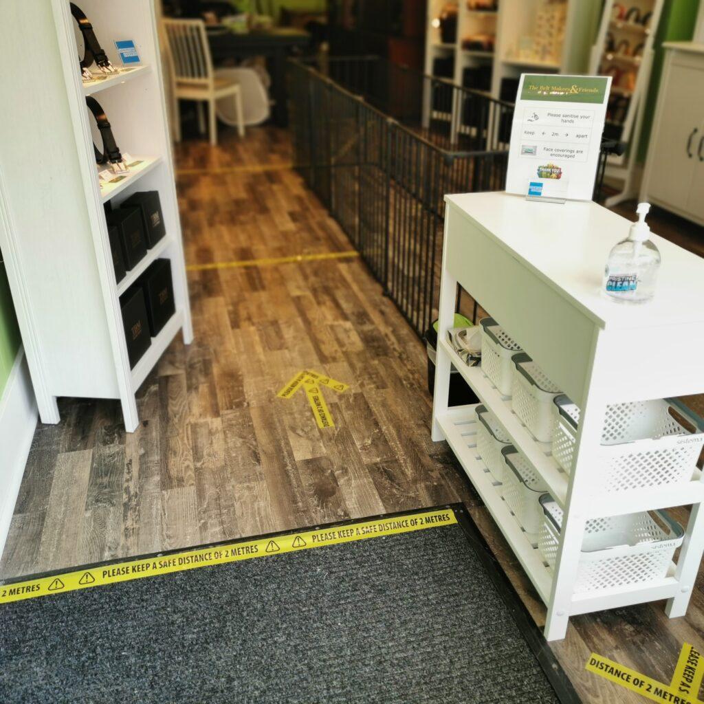 Social distancing measures: sanitising station and floor flow markings